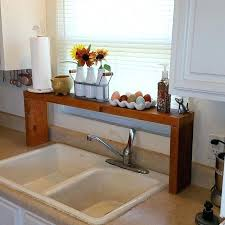 over the sink shelf crafty in kitchen home over the sink shelf under sink storage ideas