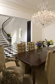 minneapolis linear strand crystal chandelier dining room mediterranean with table traditional chairs white and black floor