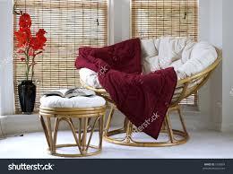 Papasan Chair In Living Room Papasan Chair W Cushion Stool Vase Stock Photo 1558834 Shutterstock