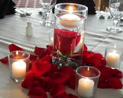 red submerged centerpieces | The centerpieces consisted of submerged red  roses & floating candles.
