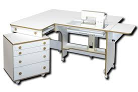 Sewing Furniture & Introducing Cloud 9 by Fashion Cabinets of America No Corners for your quilt,  drapery, or dress to catch on!!!! Free Installation Free Consultation Adamdwight.com