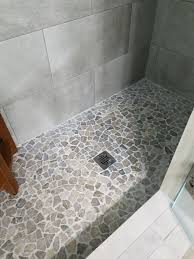minimalist stone shower floor at grey mosaic tile pebble tiles