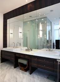 double sink vanity. this beautiful bathroom space features cane faucets, modern basins, and a sitting area. double sink vanity