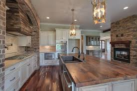 Rustic white kitchens Design Traditional Kitchen With Rustic White Cabinets Butcher Block Island And Lantern Style Pendant Lighting Designing Idea 35 Beautiful Rustic Kitchens design Ideas Designing Idea