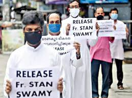 With arrest of Father Stan Swamy, a huge mass of supporters is seen flagging  to free him.