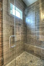 stone shower floor tile pebble wood plank wall and natural