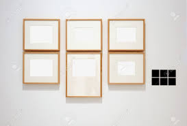 Empty picture frames on wall Wooden Six Empty Frames On White Wall In Museum With Labels Stock Photo 7102202 123rfcom Six Empty Frames On White Wall In Museum With Labels Stock Photo