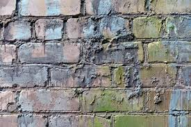 old brick wall painted with paint