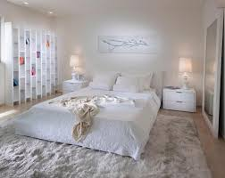 Stylish White Bedroom Interior With A Big Modern Floor Bedding On - Carpets for bedrooms
