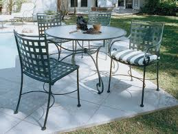 round white wrought iron outdoor dining table including folding white wrought iron outdoor dining chair and folding round white iron patio table image