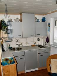 Hanging Kitchen Cabinets Gray Kitchen Cabinets With Hanging Basket On2go