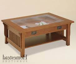 interesting glass top wooden coffee table