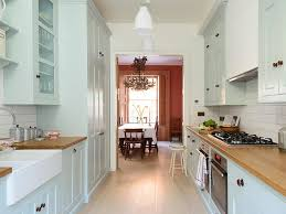 white kitchen windowed partition wall: galley kitchen takes small space design to new heights with soft colour and hard working cabinets