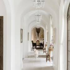 Bright, Open Hallway With Arched Ceilings