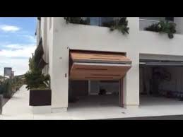 bi fold garage doorsThe Enzo 25  Upward BiFold Contemporary Garage Door  YouTube