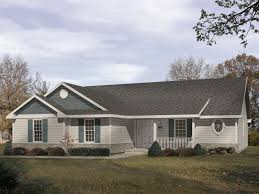 traditional ranch home has covered front porch and side entry garage