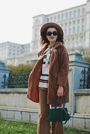 brown teddy bear coat faux fur coat striped sweater wide leg pants