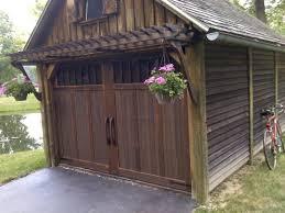 method for applying wood veneer to metal garage doors