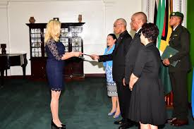 president david granger accepting the letters of credence from her excellency elisabeth eklund accrediting her the new non resident ambador of sweden to