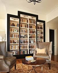 bookshelf lighting. lighting bookshelves family room transitional with wall sconces black door white walls u bookshelf m