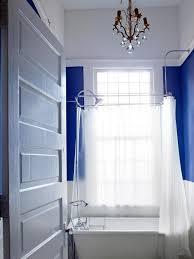 royal blue bathroom with white slipper tub