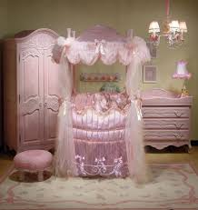 coolest baby nursery furniture design featured luxurious round crib idea and pink chandelier plus rectangular area rug