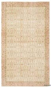 beige over dyed turkish vintage rug 5 7 x 9