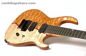 Custom Shop 3-piece Melted Top Sidewinder 7 string guitar & Custom 7 String Guitar Curly Maple Purpleheart Quilted Maple 2 Adamdwight.com