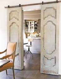 use to seperate the formal dining room from kitchen formal living room decorating in small places to save e install old doors on rollers