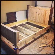 DIY full size bed frame almost finished, made with 2x4s, 2x8s, and ...