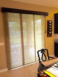 wood sliding door with blinds between glass panel vertical patio window