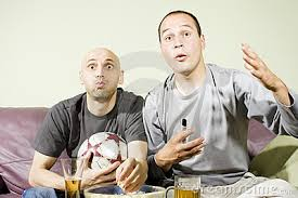 two young men watching a football match on tv royalty stock two young men watching a football match on tv royalty stock image image 14843176