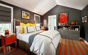 Fantastic boy's bedroom with charcoal gray walls and a white vaulted  ceiling.