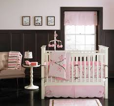 decorating ideas using dark brown baby room wainscoting including scallop light pink baby bed valance and light pink flower baby bedding set image