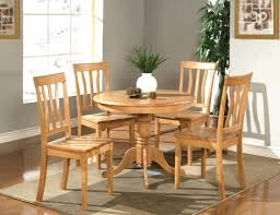simple dining table simple dining room design with 5 piece round oak kitchen table set light oak plain wood dining chairs and rectangular brown rug under