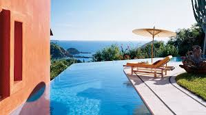 infinity pool beach house. Pure Blue Water Runs To The Edge Of This Infinity Pool With Amazing Views Beach House R