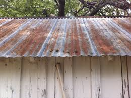 corrugated metal roof 24 with corrugated metal roof