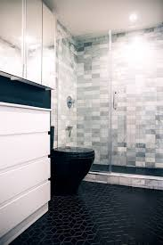 in the new bathroom the couple chose black floor tile from wayfair selecting a