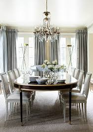 this gray and cream formal dining room with gold and crystal accents is nothing short of sheer glamour