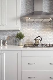 tiny mother of pearl tiles for a chic and glam kitchen look