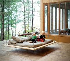 hanging bed outdoor relaxing suspended outdoor beds that will transform your summer decor 1 round hanging hanging bed outdoor