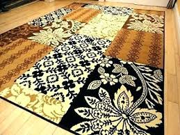 s outsting green brown cream rug and