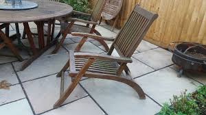 strong wooden garden dining table and 6 chairs
