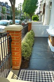 victorian front garden design london red rubber brick wall with yellow composite pier cap and mosaic tile path and paving moving home victorian front
