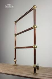 perrin rowe lifestyle: antique copper and brass towel rail