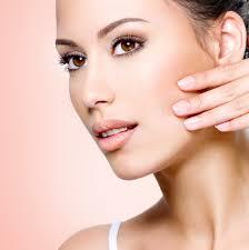 portrait of beautiful woman touching skin of face