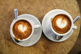 two coffee cups with coffee.  Coffee In Two Coffee Cups With E