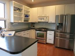 lauren painted kitchen cabinets before lauren painted kitchen cabinets after