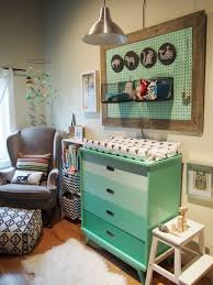 ombre mint changing station with a pegboard storage above it