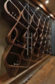 This wine cellar style is known as the Q Curve and holds approximately 380  bottles within curved wood wine racks. This one-of-a-kind Architectural ...